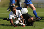 04 November 2009: Florida State's Tiffany McCarty (14) and Duke's Tara Campbell (right) collide while challenging for the ball. The Florida State University Seminoles defeated the Duke University Blue Devils 2-0 at Koka Booth Stadium in WakeMed Soccer Park in Cary, North Carolina in an Atlantic Coast Conference Women's Soccer Tournament Quarterfinal game.