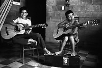Two young boys from the Music for Hope project taking part in a music lesson led by UK based tutor Katherine Rogers.<br />