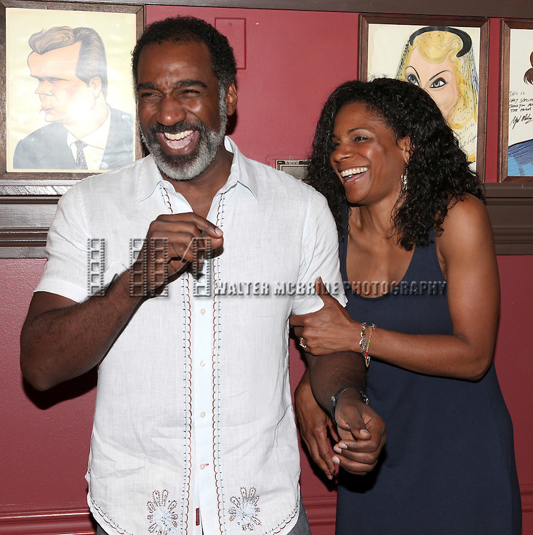 Norm Lewis & Audra McDonald.attending the celebration for Norm Lewis receiving a Caricature on Sardi's Hall of Fame in New York City on 5/30/2012