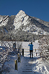 Woman photographer at Chautauqua Park in snow, Boulder, Colorado, .  John leads private photo tours in Boulder and throughout Colorado. Year-round.