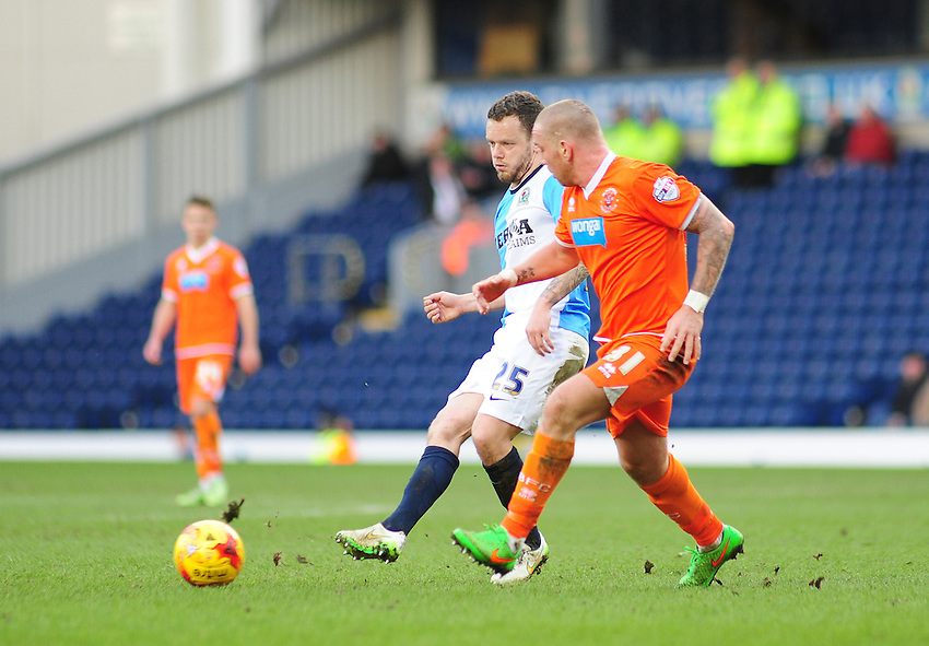 Blackburn Rovers' Jay Spearing gets a pass away under pressure from Blackpool's Jamie O'Hara<br /> <br /> Photographer Andrew Vaughan/CameraSport<br /> <br /> Football - The Football League Sky Bet Championship - Blackburn Rovers v Blackpool - Saturday 21st February 2015 - Ewood Park - Blackburn<br /> <br /> &copy; CameraSport - 43 Linden Ave. Countesthorpe. Leicester. England. LE8 5PG - Tel: +44 (0) 116 277 4147 - admin@camerasport.com - www.camerasport.com