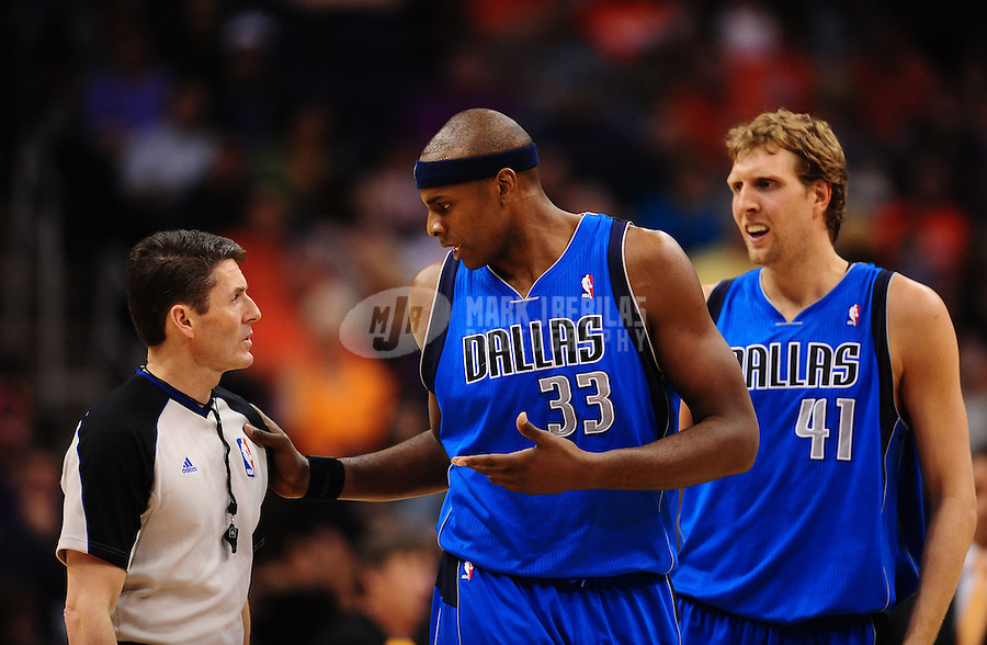 Mar. 27, 2011; Phoenix, AZ, USA; NBA referee Scott Foster (left) talks with Dallas Mavericks center (33) Brendan Haywood as forward (41) Dirk Nowitzki looks on against the Phoenix Suns at the US Airways Center. Mandatory Credit: Mark J. Rebilas-
