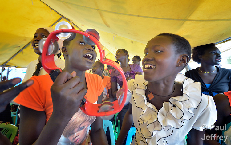 Women sing during a Roman Catholic Mass on Easter morning, April 5, inside a United Nations base in Juba, South Sudan, where some 34,000 people have sought protection since violence broke out in December 2013. More than 112,000 people currently live on UN bases in the war-torn country, most of them afraid of tribally targeted violence. The Catholic Church has maintained a pastoral presence inside the camps.