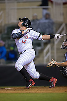 Corey Zangari (14) of the Kannapolis Intimidators follows through on his swing against the Hickory Crawdads at Kannapolis Intimidators Stadium on April 9, 2016 in Kannapolis, North Carolina.  The Crawdads defeated the Intimidators 6-1 in 10 innings.  (Brian Westerholt/Four Seam Images)