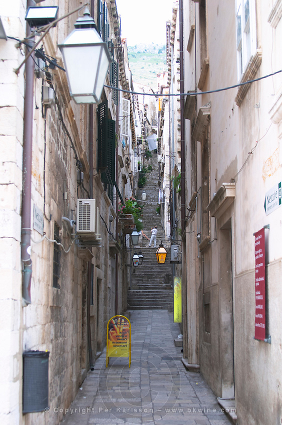 A side street with narrow steps leading up Dubrovnik, old city. Dalmatian Coast, Croatia, Europe.
