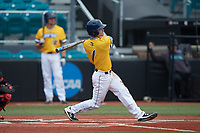 Caleb Webster (1) of the UNCG Spartans follows through on his swing against the San Diego State Aztecs at Springs Brooks Stadium on February 16, 2020 in Conway, South Carolina. The Spartans defeated the Aztecs 11-4.  (Brian Westerholt/Four Seam Images)