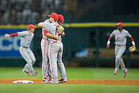 Louisiana-Lafayette Ragin' Cajuns shortstop Joe Robbins (right) gets a hug from second baseman Stefan Trosclair (23) following their win over the Rice Owls in game nine of the Shriners Hospitals for Children College Classic at Minute Maid Park on February 28, 2016 in Houston, Texas.  The Ragin' Cajuns defeated the Owls 4-2.  (Brian Westerholt/Four Seam Images)