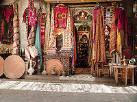 A fabric and clothes shop in a souq in the Old City, Damascus, Syria