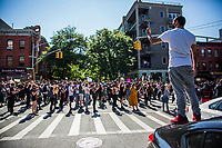 NEW YORK, NEW YORK - JUNE 03: A man on a car looks at protesters marching during a protest against the death of George Floyd on June 3, 2020 in Brooklyn, New York. The protests spread across the country in at least 30 cities across the United States, over the death of the unarmed black man George Floyd at the hands of a police officer, this is the latest death in a series of police deaths of black Americans. (Photo by Pablo Monsalve / VIEWpress via Getty Images)