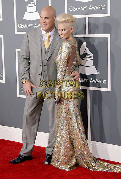 Tito Ortiz, Jenna Jameson.The 55th Annual GRAMMY Awards held at STAPLES Center, Los Angeles, California, USA..February 10th, 2013.grammys full length grey gay suit gold dress couple sequins sequined cut out back arm around waist looking over shoulder .CAP/ADM.©AdMedia/Capital Pictures.
