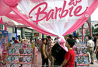 Chinese consumers look around an exhibition featuring the American Barbie Dolls in Beijing, China..16-JUL-04