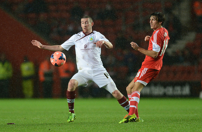Burnley's David Jones battles with Southampton's Jack Cork<br /> <br /> Photo by Ian Cook/CameraSport<br /> <br /> Football - FA Challenge Cup Third Round - Southampton v Burnley - Saturday 4th January 2014 - St Mary's Stadium - Southampton<br /> <br />  &copy; CameraSport - 43 Linden Ave. Countesthorpe. Leicester. England. LE8 5PG - Tel: +44 (0) 116 277 4147 - admin@camerasport.com - www.camerasport.com
