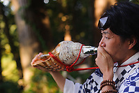 Yamabushi Masanori Naruse blowing a conch shell horn,  Mt Haguro, Dewa Sanzan, Tsuruoka-city, Yamagata Prefecture, Japan, October 16, 2012.