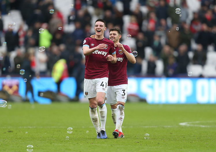 West Ham United's Declan Rice and Aaron Cresswell celebrate at the end of the game<br /> <br /> Photographer Rob Newell/CameraSport<br /> <br /> The Premier League - West Ham United v Arsenal - Saturday 12th January 2019 - London Stadium - London<br /> <br /> World Copyright © 2019 CameraSport. All rights reserved. 43 Linden Ave. Countesthorpe. Leicester. England. LE8 5PG - Tel: +44 (0) 116 277 4147 - admin@camerasport.com - www.camerasport.com