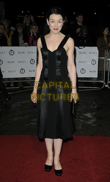 OLIVIA WILLIAMS.London Critics' Circle Film Awards at BFI Southbank, London, England..February 10th 2011.ALFS full length black  dress shoes clutch bag .CAP/CAN.©Can Nguyen/Capital Pictures.