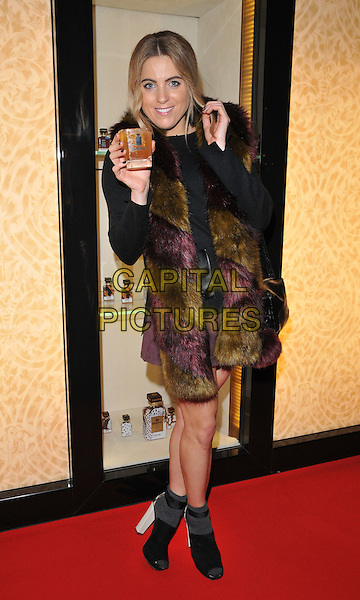 Olivia Cox attends the #Disaronno Wears Cavalli cocktail reception to mark new Disaronno Limited Edition bottle by Cavalli, Roberto Cavalli boutique, Sloane Street, London, England, UK, on Wednesday 04 November 2015. <br /> CAP/CAN<br /> &copy;Can Nguyen/Capital Pictures
