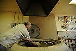 Basil Ushveridze, a Georgian immigrant and baker, bakes traditional Georgian bread in a firewood and coal kiln at the Argo Georgian Bakery on West Devon Avenue in Chicago, Illinois on May 7, 2008.  Indian, Pakistani, Muslim and Jewish, Devon Avenue in the West Rogers Park neighborhood is an eclectic representation of the world.