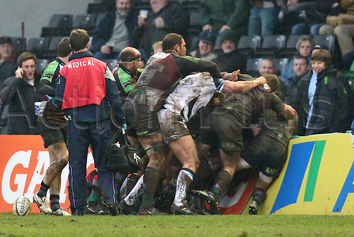 18.02.2011 Players crash into advertising boards during match fight Aviva Premiership Rugby from the Stoop. Harlequins v Sale Sharks.