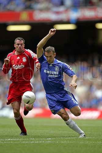 13 August 2006: Chelsea striker Andriy Shevchenko competes for the ball with Jamie Carragher during The FA Community Shield played between Chelsea and Liverpool at the Millennium Stadium, Cardiff, Wales. Liverpool won the match 2-1. Photo: Glyn Kirk/Actionplus....060813 football soccer player
