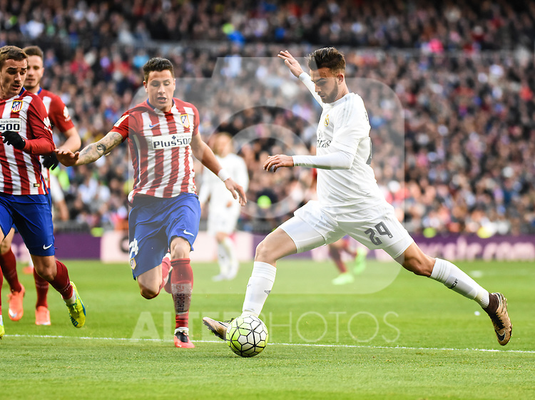 Real Madrid´s Mayoral and Atletico de Madrid´s Gimenez during 2015/16 La Liga match between Real Madrid and Atletico de Madrid at Santiago Bernabeu stadium in Madrid, Spain. February 27, 2016. (ALTERPHOTOS/Javier Comos)