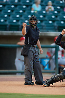 Umpire Cody Clark calls a strike during a Southern League game between the Chattanooga Lookouts and Birmingham Barons on July 24, 2019 at Regions Field in Birmingham, Alabama.  Chattanooga defeated Birmingham 9-1.  (Mike Janes/Four Seam Images)
