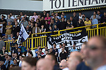 A supporter folding away his banner in the East Stand towards the end of the second-half as Tottenham Hotspur took on Watford in an English Premier League match at White Hart Lane. Spurs were due to make an announcement in April 2016 regarding when they would move out of their historic home and relocate to Wembley as their new stadium was completed. Spurs won this match 4-0 watched by a crowd of 31,706, a reduced attendance figure due to the ongoing ground redevelopment.
