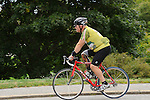 Adult male cyclist with prosthetic leg, Chatham, MA.