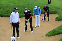Justin Rose, Ian Poulter (ENG), Wu Ashun (CHN) and Paul McGinley (IRL) at the 18th for a bunker challenge during Wednesday's Pro-Am Day of the 2014 BMW Masters held at Lake Malaren, Shanghai, China 29th October 2014.<br /> Picture: Eoin Clarke www.golffile.ie