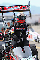 Apr 10, 2015; Las Vegas, NV, USA; NHRA top fuel driver Steve Torrence getting into his car during qualifying for the Summitracing.com Nationals at The Strip at Las Vegas Motor Speedway. Mandatory Credit: Mark J. Rebilas-