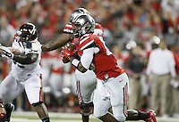 Ohio State Buckeyes quarterback J.T. Barrett (16) rolls out against Virginia Tech during the 1st quarter of their college football game in Columbus, Ohio on Septemeber 6, 2014. (Dispatch photo by Kyle Robertson)