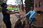 Cherie Michaux, left, with her daughter Ja'liza Michaux, 12, right, and son Ja'kye Brown, 7, center foreground, and her nephew Quaheem Moreau, 3, background, playing with leaves in Port Chester, NY on October 27, 2012. Cherie Michaux could have benefitted if Westchester County had integrated its housing as it had been ordered to do so.