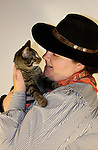 A cowgirl holding a kitten