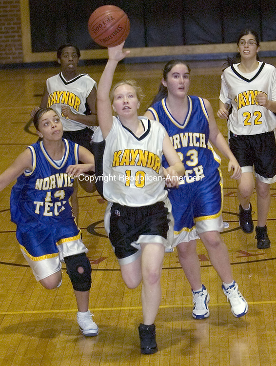 WATERBURY, CT. 20 December 2006--122106SV05--#10 Molly Markie of Kaynor Tech. tries to control the loose ball in front of #14 Deliness Muniz and #23 Lacey DePolico of Norwich Tech. during basketball action in Waterbury Thursday.<br /> Steven Valenti Republican-American