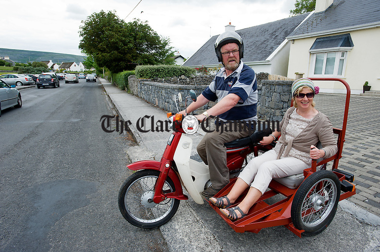 John Hogan drives Brenda Clarke in his home made side car during a vintage run as part of Feile an Samhraidh at Ballyvaughan. Photograph  by John  Kelly.