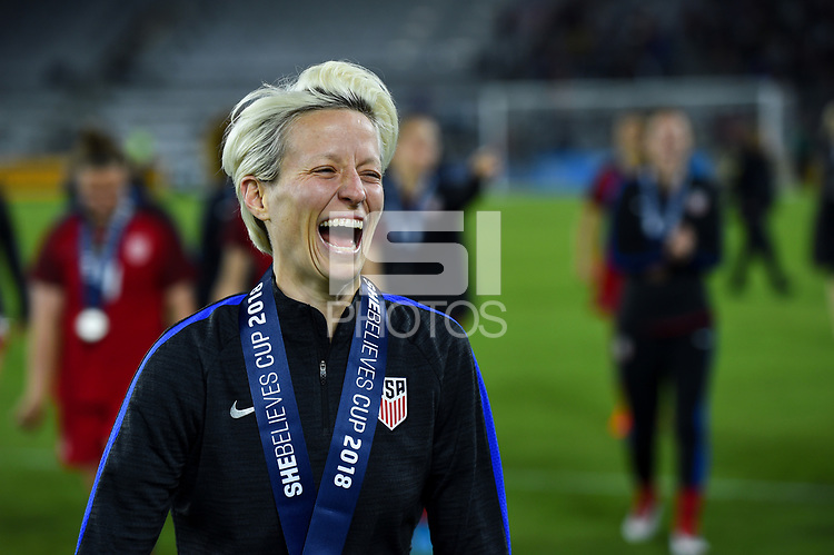 Orlando City, FL - Wednesday March 07, 2018: Megan Rapinoe celebrates SheBelieves Cup 2018 Champions during a 2018 SheBelieves Cup match between the women's national teams of the United States (USA) and England (ENG) at Orlando City Stadium.