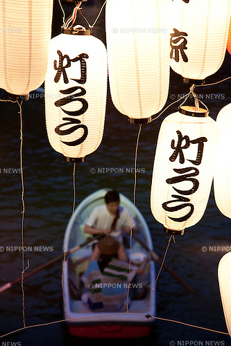 "July 13, 2012, Tokyo, Japan - Chidorigafuchi Park Visitors wait patiently in the boat the beginning of the Toro-nagashi ceremony in Tokyo. Toro-nagashi is a Japanese ceremony where participants put float paper lanterns in the water; ""toro"" is a Japanese word it means ""lantern"", and ""nagashi"" means ""cruise, flow"". According to tradition, these lights show a way for the spirits of the dead to the afterlife..."