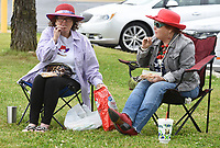 Diane Davidson (left) eats with her sister Shannon Mott, both members of the Red Hat Hotties, as they sit with other members Wednesday, May 20, 2020, outside in front of the Rogers Adult Wellness Center in Rogers. The social group would normally meet inside the center but it is closed do to the covid-19 pandemic. The group has decided to meet every other Wednesday for lunch and a visit outside the center. Check out nwaonline.com/200521Daily/ and nwadg.com/photos for a photo gallery.<br /> (NWA Democrat-Gazette/David Gottschalk)