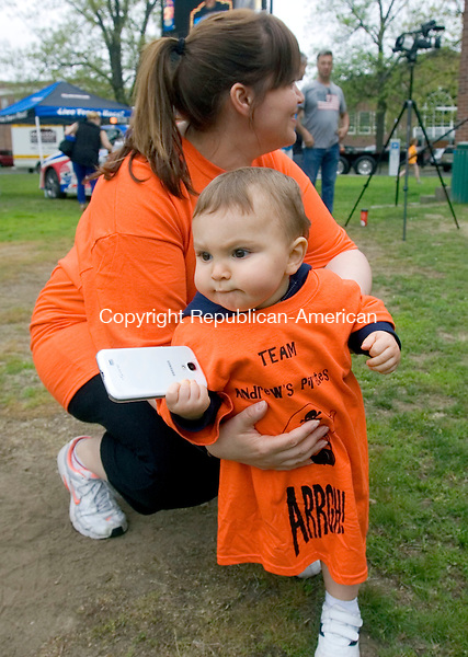 WATERBURY CT. 09 May 2015-050915SV04-Nicholas Tessier , 1, of Wolcott  can&rsquo;t wait to walk with his mom Deanna Tessier as they watch the opening ceremonies of the 6th annual Western Connecticut Walk Now for Autism Speaks in Library Park in Waterbury Saturday. <br /> Steven Valenti Republican-American