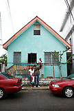 BELIZE. Belize City, the Ramirez family in front of their home on Albert Street