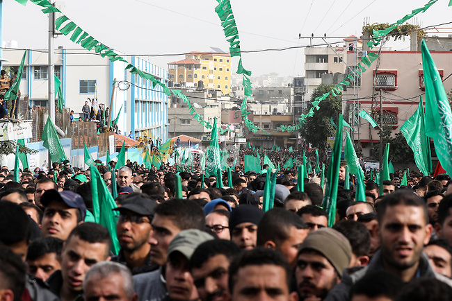 Palestinian Hamas supporters gather to attend a Hamas rally marking the 32th anniversary of the Islamist movement's founding In Jabalia, northern Gaza Strip, on December 13, 2019. Photo by Mahmoud Nasser