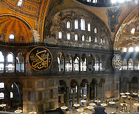 High angle view of interior, Hagia Sophia, 532-37, by Isidore of Miletus and Anthemius of Tralles, Istanbul, Turkey. Hagia Sophia, The Church of the Holy Wisdom, has been a  Byzantine church and an Ottoman mosque and is now a museum. The current building, the third on the site, commissioned by Emperor Justinian I, is a very fine example of Byzantine architecture. The historical areas of the city were declared a UNESCO World Heritage Site in 1985. Picture by Manuel Cohen.