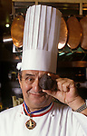 French chef Paul Bocuse in Lyon France holding a large black truffle.