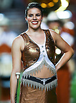 A Texas Longhorns baton twirler warms up before the game between the Oklahoma State Cowboys and the University of Texas in Austin Texas Longhorns at the Daryl K. Royal- Texas Memorial Stadium in Austin, Texas. The Oklahoma State Cowboys defeated the Texas Longhorns 33 to 16.