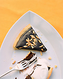 ITALY, Orvieto, Umbria, plate with fork and slice of dark chocolate and pine nut crostata