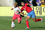 11 February 2006: Costa Rica's Mauricio Solis (8) and Korea's Chun-Soo Lee (14) fight for the ball. The Costa Rica Men's National Team defeated South Korea 1-0 at McAfee Coliseum in Oakland, California in an International Friendly soccer match.