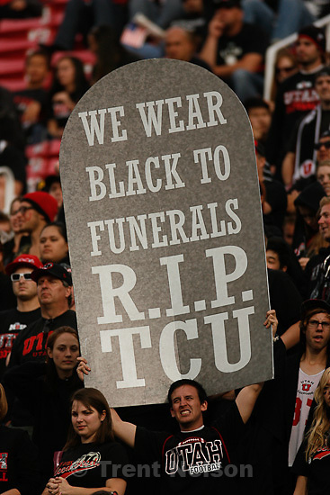 "Trent Nelson  |  The Salt Lake Tribune. during the second half, Utah vs. TCU college football, Saturday, November 6, 2010. TCU won 47-7. fan with sign ""we wear black to funerals rip tcu"""