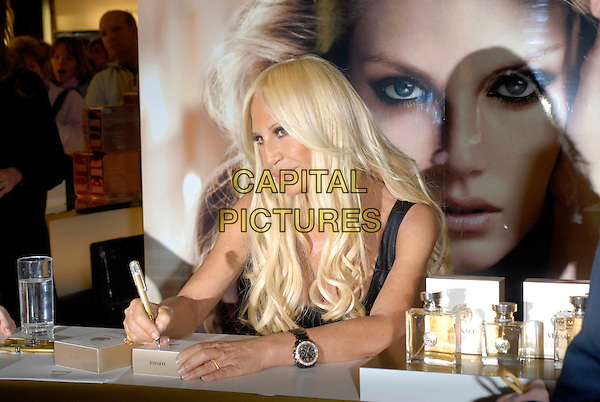 DONATELLA VERSACE.The Italian fashion designer signs copies of her new perfume at Harrods, London, England..March 27th, 2007.perfume half length black top pen autograph .CAP/FIN.©Steve Finn/Capital Pictures