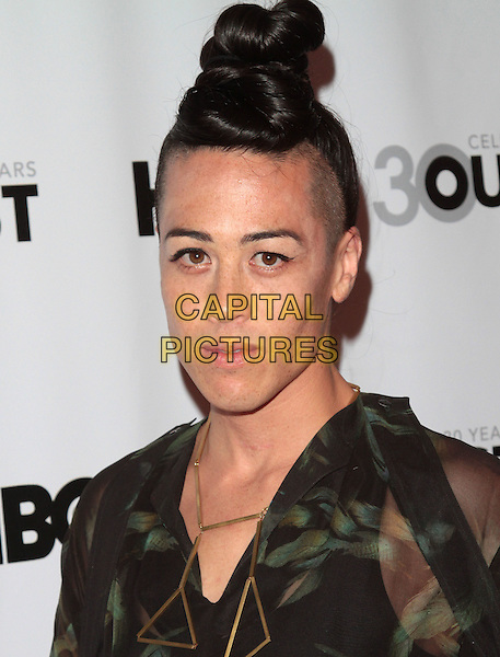 Wu Tsang.The 2012 Outfest Opening Night Gala of Vito held at Orpheum Theatre, os Angeles, California, USA..12th July 2012.headshot portrait black green print sheer hair up bun  .CAP/ADM/ORC.©ORC/AdMedia/Capital Pictures.