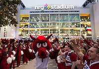 Arkansas Democrat-Gazette/BENJAMIN KRAIN --12/29/2014--<br /> Arkansas fans line up outside RNG Stadium in Houston waiting on the arrival of the team before Monday night's Texas Bowl.