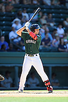 Right fielder Nick Longhi (21) of the Greenville Drive bats in a game against the Charleston RiverDogs on Sunday, June 28, 2015, at Fluor Field at the West End in Greenville, South Carolina. Longhi is the No. 27 prospect of the Boston Red Sox, according to Baseball America. Charleston won, 12-9. (Tom Priddy/Four Seam Images)